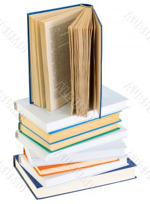 Pyramid from books with color covers on a white background
