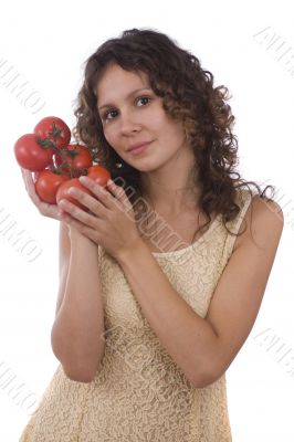 Woman holding branch of red tomatoes