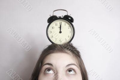 The girl and an alarm clock.