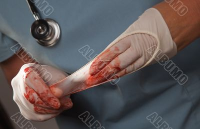 Abstract of Doctors Bloody Surgical Gloves