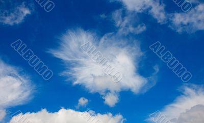 White cumulus cloud in blue sky