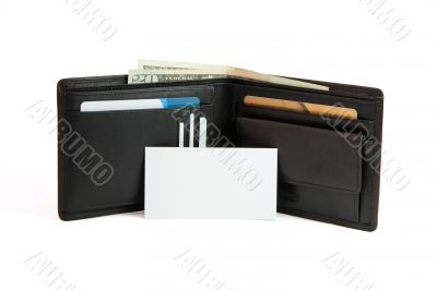 White business card in front of wallet isolated