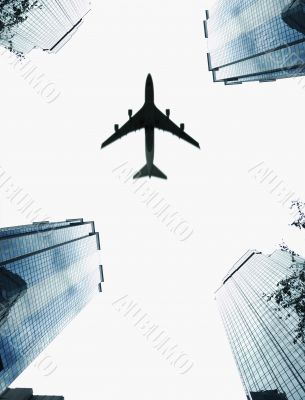 Plane Traveling Above City