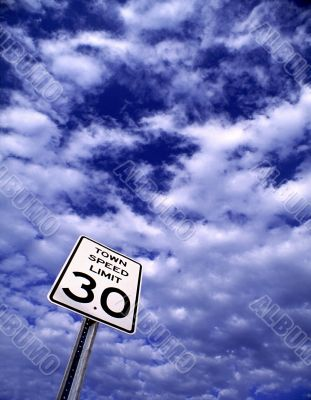 Speed Limit Sign Against Cloudy Sky