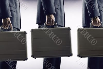 Rat Race . Businesspeople with luggage
