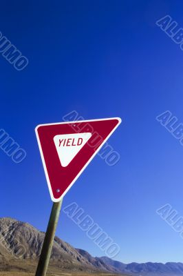 yield sign at the blue sky