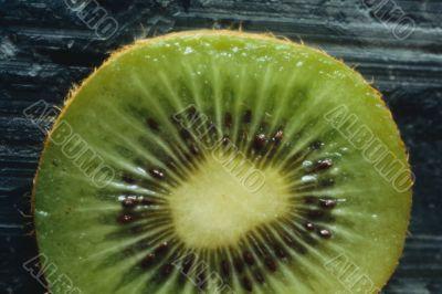 Green kiwi fruit slice.