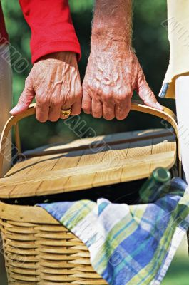 Senior Couple Carrying Picnic Basket