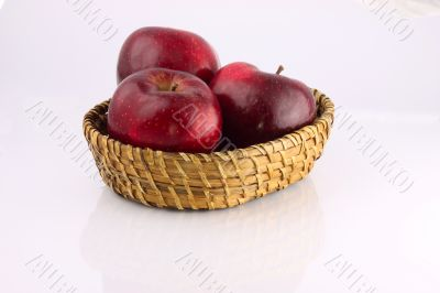 Red apples in a wicker plate