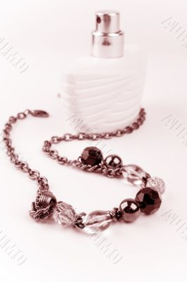 necklace and parfume bottle