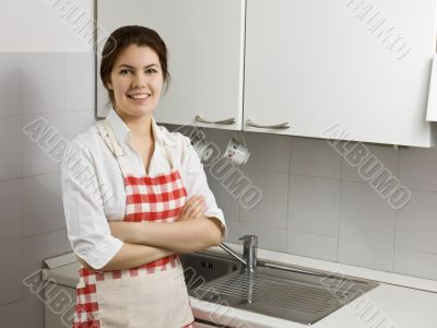 Woman alone in the kitchen