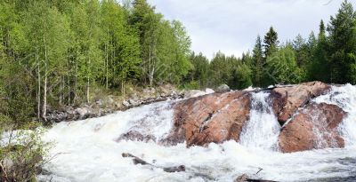 Panoramic photo of a waterfall  - summer