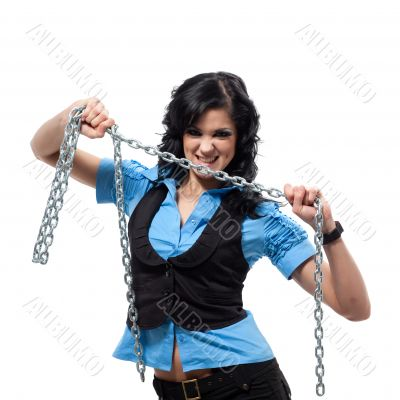 Woman in blue clothes is shackled