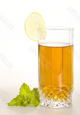 breakfast still-life. green tea with lemon and fresh mint