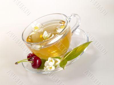 breakfast still-life. green tea with cherry and fresh jasmine