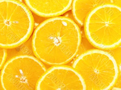 fresh tasty oranges as background on the stack