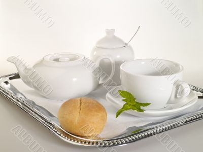 breakfast still-life with dishware and mint leafs