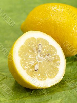fresh tasty lemon on green background