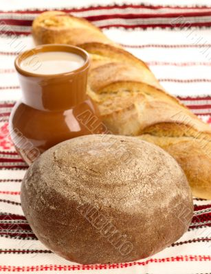 Delicious bread on traditional peasant textile background