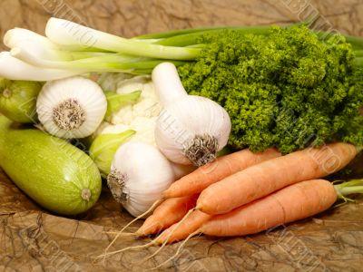 fresh tasty vegetables on brown background