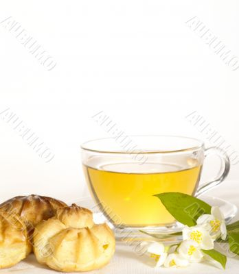 breakfast still-life. green tea with cookies and fresh jasmine