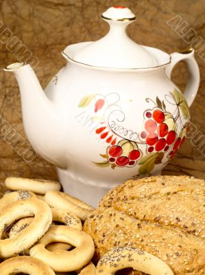 Delicious peasant bread with teapot and crisp