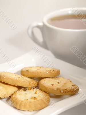 tea cup with cookies on the plate