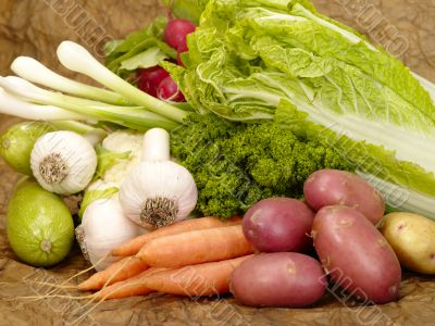 fresh tasty vegetables on brown background