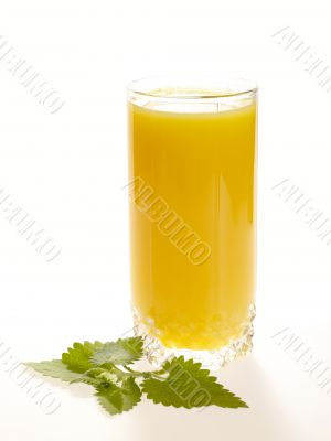 Orange juice on the table with fresh mint