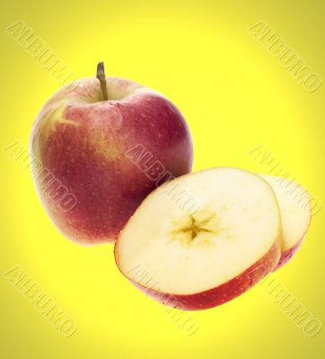 sliced apple on yellow background