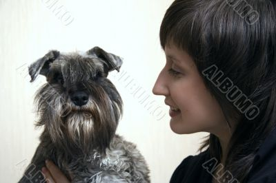 Schnauzer and its owner