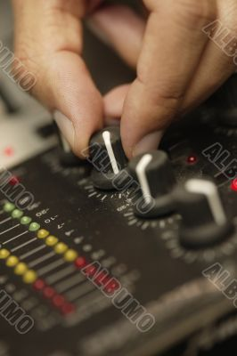 Disc Jockey Turning Dial on Sound Board