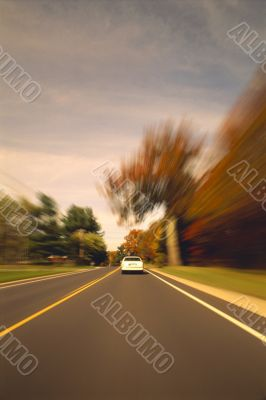 Automobile Driving Down Scenic Country Road
