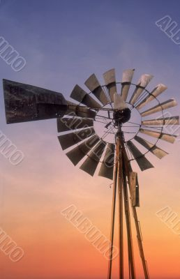 Windmill at sunset sky