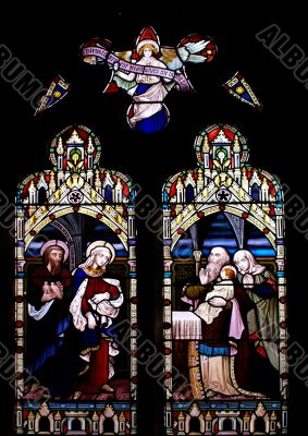Stained glass in old church in Beaumaris