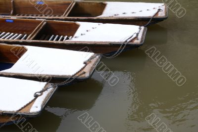 Snow-covered punts in Cambridge