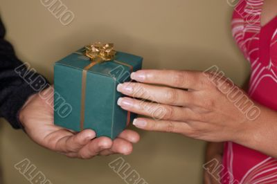 gift giving. Couple hands