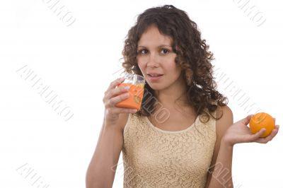 Woman is drinking orange juice.