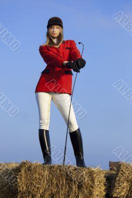 girl jockey / on a background of blue sky