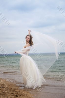 beautiful bride  dancing on the beach