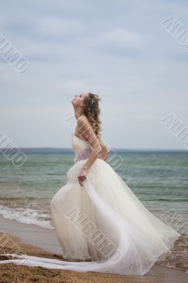 beautiful bride  dancing on the beach