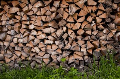 Background with pile of wooden logs