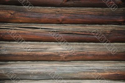 Fragment of old country wooden house wall