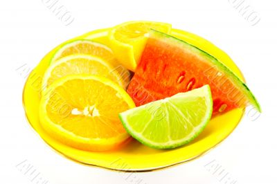 Citrus Fruit on a Yellow Plate