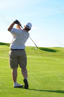 Young golfer on the fairway
