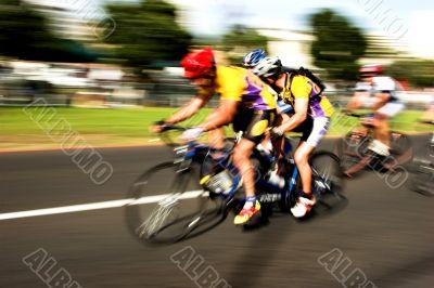 Tandem cyclists compete motion blur