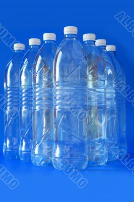 Mineral water bottle isolated on white background, close up