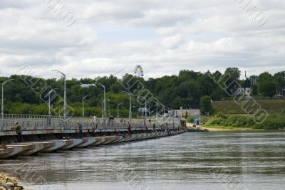 Pontoon-bridge on river for automobiles and people