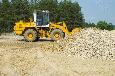 Heavy bulldozer loading ballast