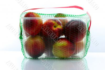 peaches packed in a plastic container